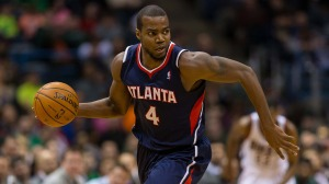 Jan 25, 2014; Milwaukee, WI, USA; Atlanta Hawks forward Paul Millsap (4) during the game against the Milwaukee Bucks at BMO Harris Bradley Center.  Atlanta won 112-87.  Mandatory Credit: Jeff Hanisch-USA TODAY Sports